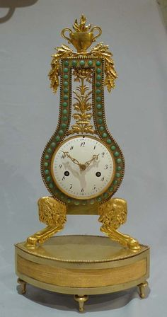Antique French Louis XVIth Period Mantel Clock Of Lyre Form, On Oval Base With Inset Ormolu Panels Finely Matted And The Top Of The Base With Applied Ormolu Beading - French   c.1785