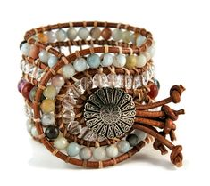 A bohemian trend bracelet with carefree essence!!! Semi precious stones of amazonite, mutli colored agate & crystal are framed by natural brown leather woven together with beige cotton cord. This eye catching design also features a silver, repousse metal, button closure.This gipsy style bracelet upgrades your look, easy to wear it in any occasion