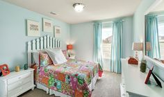 Here is a girls bedroom and what a great idea for a headboard! ^KL