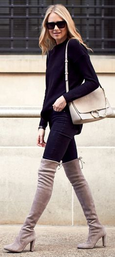Amy Jackson + glamorous fall style + totally owning the vibrant contrast + beige boots and otherwise black outfit + coloured pair of thigh high boots + understated all black style + awesome look.    Sweater/Trousers: Nordstrom, Boots: Stuart Weitzman, Handbag: Chloe.
