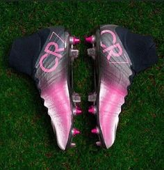 Pink and black CR7 soccer cleats