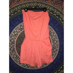 Swimsuit Coverup/ Casual Romper This romper can be used as a swimsuit coverup OR as a casual romper! It is a very pretty coral color and has pockets at the waist.  It has never been worn because it is too big for me! Forever 21 Swim Coverups