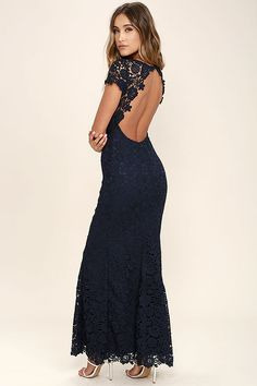 0fc70190fe You ll be the fairest of them all in the My Flare Lady Navy Blue Lace Maxi  Dress! Lace dress has sheer cap sleeves