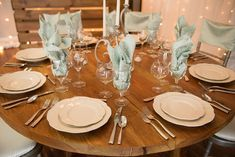 Mint Tavira Napkins and Chiavair Chair Caps add a pop of color to this beautiful wood dining table from Camelot Party Rentals