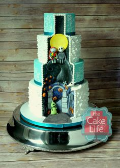 Nightmare Before Christmas wedding cake. This was the hidden scene featuring Jack & Sally with zero and Oogie Boogie made from fondant. www.facebook.com/thecakelife