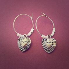 Handmade Heart Earrings Little hoops with white beads and silver colored hearts. Jewelry Earrings