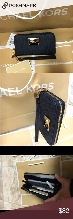 Michael kors wristlet/wallet navy Authenic brand new with tag. Baltic blue (navy like color). Bigger on gold hard wear, imported from original mk store. Michael Kors Bags Clutches & Wristlets