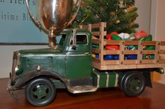 vintage toy truck with Christmas bulbs