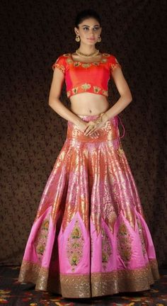 Light Lehengas - Coral Red and Pink Lehenga | WedMeGood | Coral Red Crop Top with Gold Motifs on Border and Pink and Gold Banarasi Silk Lehenga with Scattered Motifs and Gold Border #wedmegood #light #lehengas #pink