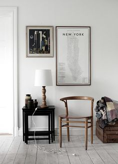 ... Candlestick wood lamp, black lacquer? Nesting tables, placement of frames w things as a happy group