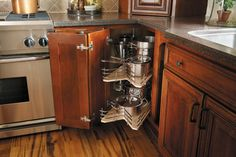 StarMark Cabinetry Square Base Corner with Revolving Slide Shelf. Shelf baskets pull out and unit rotates 90 degrees each direction so you can reach the side shelves.