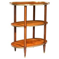 Regency Period Amboyna Etagere | From a unique collection of antique and modern shelves at https://www.1stdibs.com/furniture/storage-case-pieces/shelves/