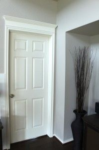 Adding crown molding above the doors...love this idea!