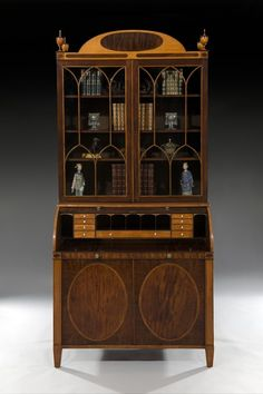 This is a Sheraton Secretaire Bookcase. It has beautiful inlays of ebony and rosewood. The urns at the top are classical elements. The diamond shaped glazing is a feature of the Sheraton style. Furniture Styles, Fine Furniture, Antique Furniture, Lancaster London, Mahogany Bookcase, Mahogany Furniture, Classical Elements, Antique Fairs, Antique Cabinets