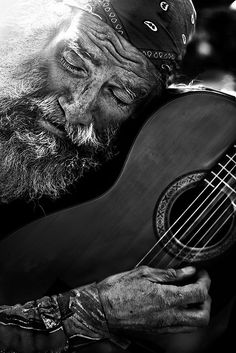 Man with his guitar and bandana and song in his heart. Black and white people on the street beautiful photography art. DdO:) - http://www.pinterest.com/DianaDeeOsborne/ddo-most-popular-re-pins/ - MOST POPULAR RE-PINS. Notice the lovely rosette of this sweet acoustic. On the guitar and bass musical instruments board of cSw - http://www.pinterest.com/claxtonw/4-5-6-strings/