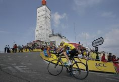 Stage winner Christopher Froome of Britain, wearing the overall leader's yellow jersey, climbs in the last 100 meters of the Mont Ventoux pass during the fifteenth stage of the Tour de France cycling race over 242.5 kilometers (150.7 miles) with start in in Givors and finish on the summit of Mont Ventoux pass, France, Sunday July 14, 2013. The riders climbed to an altitude of 1912 meters (6,273 Feet) tackling Mont Ventoux pass at the end of the longest stage of the 100th Tour de France…