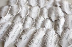 feather shaped paper place cards.