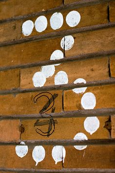 Number three made of white paint dots by Horia Varlan, via Flickr