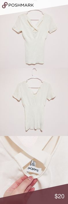 Criss-cross back cream top BEBE // Size: medium (runs small) // Color: Creamy white // Worn once and in great condition // 80% rayon, 20% spandex // Criss-cross X back, body hugging/forming, stretchy spandex material bebe Tops