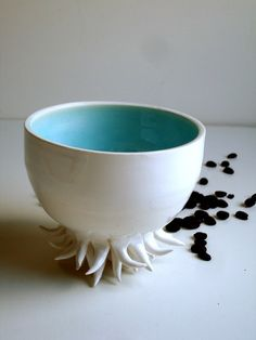 Sea urchin porcelain cup/bowl.  Soo neat... just don't set it down on your wood table, eeek.  The artist makes it in white/red also