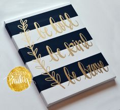 This beautiful hand painted canvas features bold hand painted black and white stripes with the inspirational text be bold be kind be brave. in hand painted in gold leaf over the stripes in a beautiful calligraphy font. This canvas is completely hand painted, not digitally printed. This