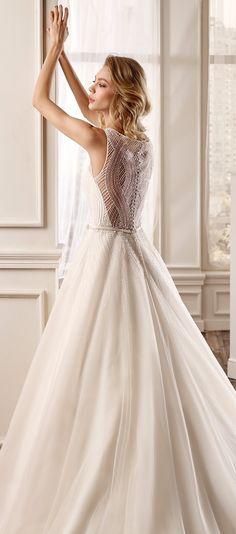 Nicole Spose 2016 wedding dress. The back of this dress is spectacular. Definitely a jaw dropper.