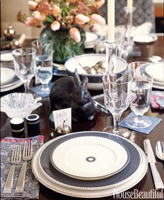 """Always write your own place cards, even if your hand-writing is quirky. It makes the setting more personal,"" says designer Thomas O'Brien. Marielle dinnerware, Marielle Indigo round bowl, Tiago slate blue urn vase, Tiago candlesticks, all by Thomas O'Brien for Reed & Barton.   - HouseBeautiful.com"