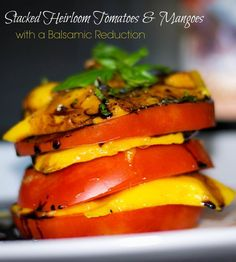 Stacked Heirloom Tomatoes & Mango with a Balsamic Reduction Sweet mangoes and fresh, ripened Jersey tomatoes stacked, then topped with a balsamic reduction. Appetizer Dips, Yummy Appetizers, A Food, Good Food, Balsamic Reduction, Heirloom Tomatoes, Salad Recipes, Dip Recipes, Salmon Burgers