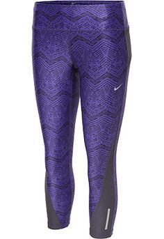 The Nike® women's printed Racer cropped tights are made of Dri-FIT® jersey fabric to keep you dry and comfortable, while the water-resistant finish and back zippered pocket add security and convenience.