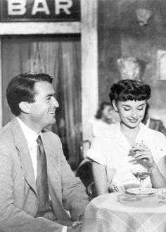Gregory Peck and Audrey Hepburn in 'Roman Holiday'. Tibernus and Rhea Silvia....very nice, very nice.