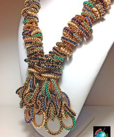 Shelley Nybakke 2014 Battle of the Beadsmith!! her designs are incredible....you can buy them on etsy!!!! sturdy girl designs :) Wowzer!!!!