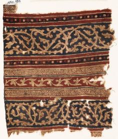 Textile fragment with bands of interlacing tendrils |  | Egypt/Fustat (possible find spot) | Gujarat  (place of creation) | 2nd half of the 14th century - 1st half of the 15th century | cotton, block-printed with mordant, dyed red, and resist-dyed blue; with stitching in cotton