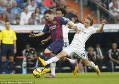 Barcelona's Lionel Messi tackled by Luka Modric and Marcelo. #halamadrid