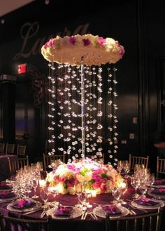 tall white flowers, white floral centerpiece, hanging florals, hanging crystals, purple and white wedding decor