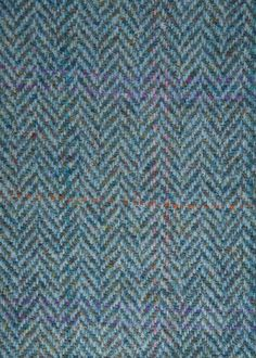 Harris Tweed Hebrides Cloth : HTHS-30 is a blue herringbone with multi-coloured overcheck.