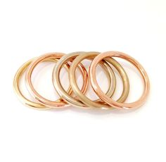 We make these rings in three widths. This is 1.9 mm. Its also available in 2.5 mm and 3 mm. Please specify polished (shiny) or satin (matte)