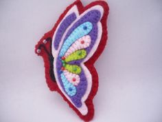 Felt Butterfly brooch, pink, purple, red, black, green, spring. $15.00, via Etsy. http://www.etsy.com/listing/40290638/felt-butterfly-brooch-pink-purple-red?ref=sr_gallery_37_includes[0]=tags_search_query=felt+butterflies_page=1_search_type=all_facet=felt+butterflies_view_type=gallery#