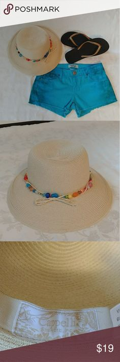 Women' Cappelli Straworld Hat So fashionable and beautiful beads and straw hat. Is a statement piece on its own. Great all summer long. 70% Paper, 30% Polyester. Great Condition. Cappelli Accessories Hats