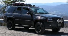 Rock Sliders / Door Guards So as the trails got more difficult, I noticed the rocks and obstacles were getting closer to the rocker panels. Slider Door, Gmc Envoy, Rock Sliders, Chevrolet Trailblazer, Chevy Girl, General Motors, Offroad, Gmc Trucks, Vehicles
