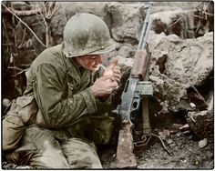 Pfc. Terry Paul Moore of Albuquerque, New Mexico. He was number one Browning Automatic Rifleman in 2nd Platoon, Company 'F', 184th Infantry Regiment of the US 7th Infantry Division and is lighting his first cigarette of the day on the island of Okinawa soon after the dawn attack on the town of Yonabaru. In the early morning of the 22nd of May 1945.