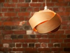 A pendant light shade hand made in the Bay of Plenty. Crafted from sustainable, plantation grown New Zealand pine, copper pins, bamboo fastening clips and recyclable polypropylene lampholders.   Each piece is hand made by me. I have chosen my materials carefully with sustainability and recycling i...