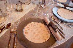 Our round wood engraved menu | www.naturallychic.ca | Photo by Julie Williams Photography. #roundweddingmenu #woodmenu