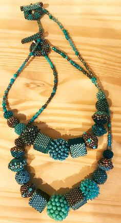 Interstellar Necklaces on turquoise by Julie Powell