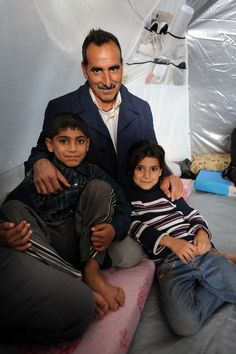 Alan Mirani, here with his son Khadr and daughter Hendirn, fled Damascus in November 2012. He now lives in a tent with his wife and five children.