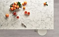 Caesarstone creates marble-like surfaces by adding pigments and additives to the quartz and polymer mixture