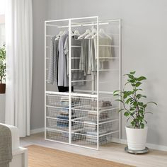 JONAXEL Frame/wire baskets/clothes rails, It can be difficult to keep things neat and tidy. JONAXEL storage system lets you utilize the spaces you have in smarter ways. Flat Pack Wardrobes, Large Wardrobes, Ikea Board, Clothes Rail Ikea, Wardrobe Shelving, Pax Wardrobe, Armoire Ikea, Couple Room, Ikea Family