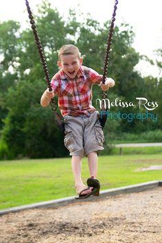Kids at play  Swings bring smiles.