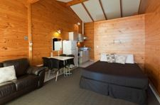 Deluxe Holiday Unit Beachfront Accommodation with an Ocean View - Lockwood Style for Ultimate Kiwi Family Holiday - Papamoa Beach Resort Holiday Resort, Beach Tops, Family Holiday, Beach Resorts, Kiwi, Ocean, The Unit, Bed, Furniture