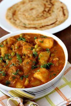 aloo matar sabji*** 1 making indian night. used 1 lg can mersano tomatoes. sub yogurt for cream. I did not like this recipe.