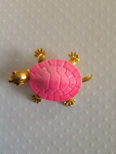 Vintage Pink Turtle Brooch with Ruby Rhinestone Eyes by QuiltsETC, $9.99 http://www.etsy.com/listing/120023248/vintage-pink-turtle-brooch-with-ruby?ref=sc_1=